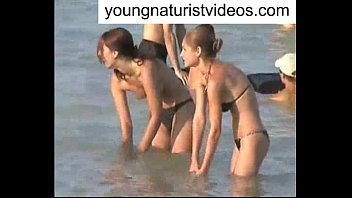 beach bent over nude Asian girl pees during 69